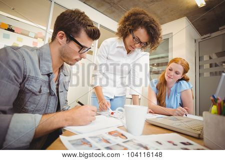 Business people looking at documents at meeting in office