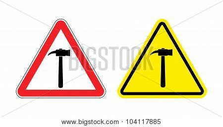 Warning Sign Attention Hammer. Hazard Yellow Sign Construction Work. Silhouette A Sledgehammer On Re