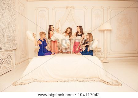 Good-looking Girls Celebrating A Bride's Bachelorette Party And Fighting With Pillows