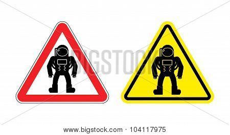 Warning Sign Astronaut. Hazard Yellow Sign Cosmic Man. Silhouette Astronaut In Space Suit With Red T