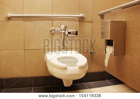 Clean white toilet stall