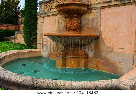 Stone vase with a little pool in a park