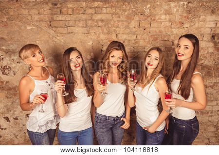Cheerful Young Women Wearing Dress Code With Sparkling Wine