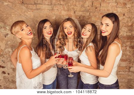 Beautiful Bride With Happy Bridesmaids Celebrating Hen-party With Red Champagne