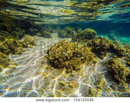 Rocks And Sand Underwater In Sardinia