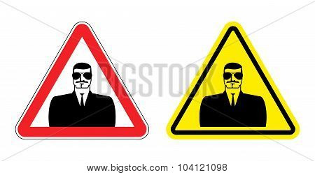 Warning Sign Of Attention To Spy. Hazard Yellow Sign Secret Agent. Silhouette  Security Guard On Red
