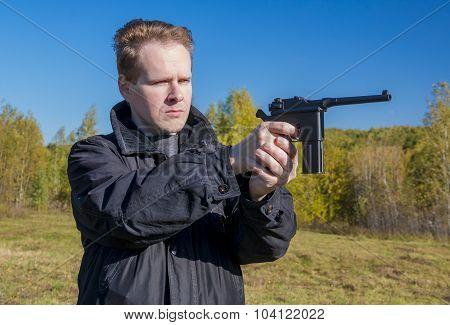 A Man Shoots A Gun Mauser