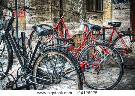 Classic Bicycles On A Bike Rack In Bologna