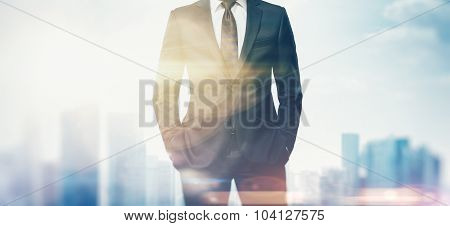 Double exposure of business man in the city.