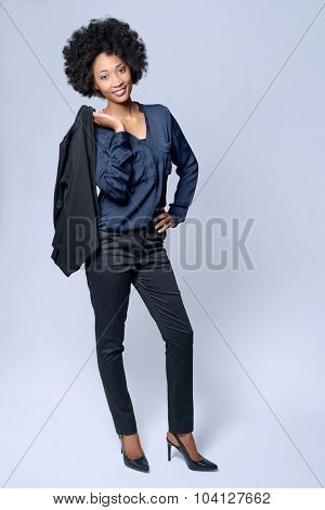 Full length portrait  of attractive young black african model wears smart business suit in studio and smiling
