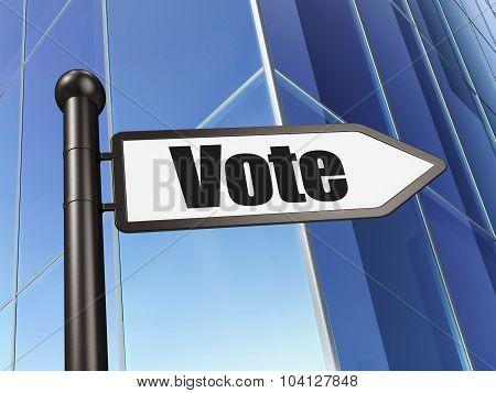 Political concept: sign Vote on Building background