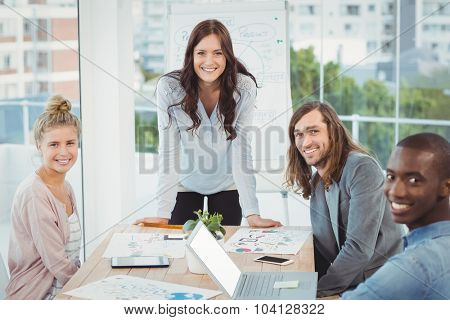 Portrait of smiling business team at desk in office