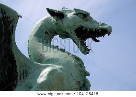 LJUBLJANA, SLOVENIA - JUNE 30: Dragon - symbol of the Slovenian capital on the Dragon Bridge in Ljubljana, Slovenia on June 30, 2015