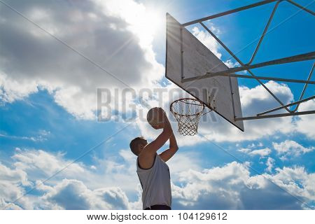 Clouds Over A Basketball Player