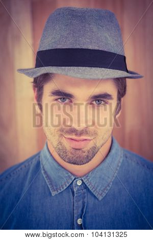 Close-up portrait of confident hipster wearing hat in office