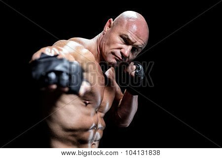 Fighter with confident gloves against black background