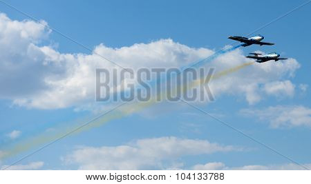 Kharkiv, Ukraine - August 24, 2015: planes performing colorful trails at Kharkiv airshow
