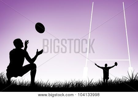Full length of rugby player catching the ball against purple vignette