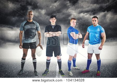 Tough rugby players against stormy sky