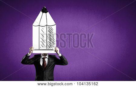 Businessman hiding his face behind paper sheet