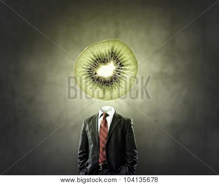 Headless businessman with kiwi instead of head