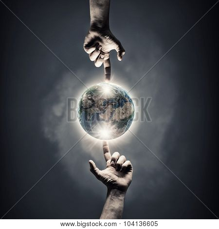 Close up of human hands touching with fingers. Elements of this image are furnished by NASA