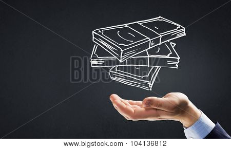 Businessman hand holding drawn banknotes in palm