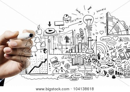Close up of businessman drawing business sketches on screen