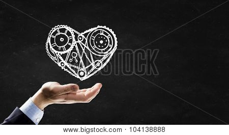 Person hand and chalk drawing of heart