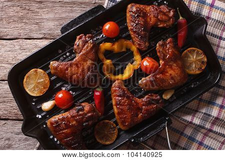 Bbq Chicken Wings With Vegetables In A Pan Close-up. Horizontal Top View