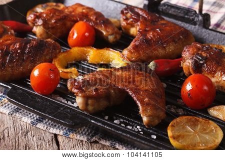 Grilled Chicken Wings With Vegetables In A Grill  Pan Close-up. Horizontal