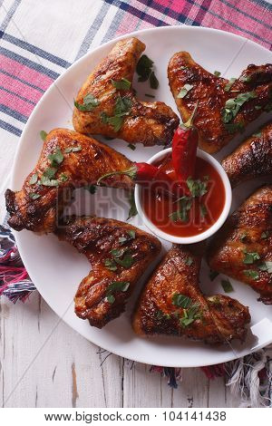 Grilled Chicken Wings With Sauce Chilli Close-up. Vertical Top View