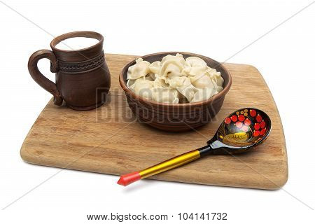 Russian Dumplings And A Mug With Milk On A White Background