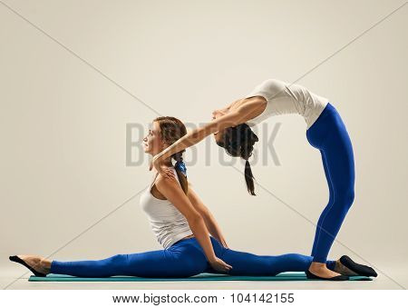 yoga in pair training. the splits and Bridge Pose