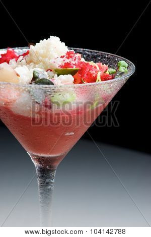 Cup gazpacho with cherries.