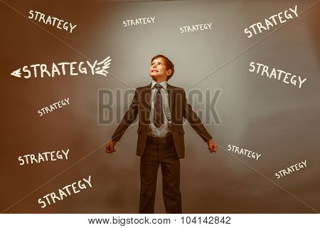 Teen boy businessman arms outstretched looking up striving for s