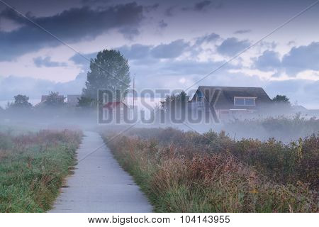 Dutch Farmhouse In Dense Morning Fog
