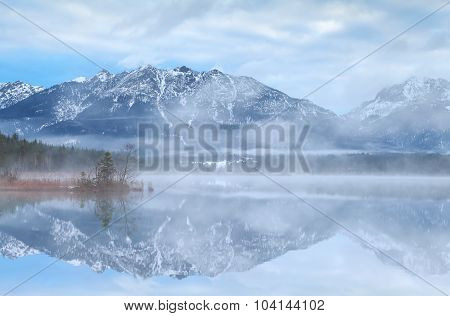 Beautiful Misty Morning On Lake In Alps