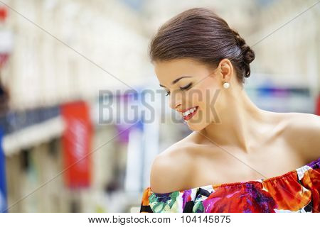 Portrait close up of young beautiful woman in red dress