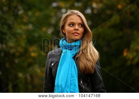 Portrait close up of young beautiful blonde women walking, on background autumn park