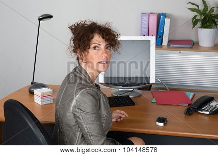 Business Girl At Office Looking At The Camera