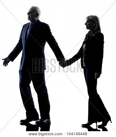 one caucasian couple senior silhouette  in silhouette studio isolated on white background