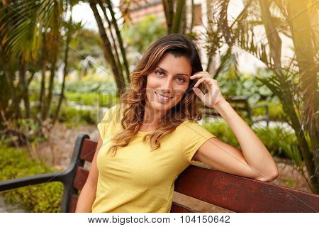 Smiling Lady Looking At Camera With Hand In Hair