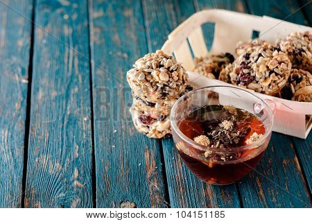 Cup Of Tea And Cookies Made Of Nuts And Raisins.