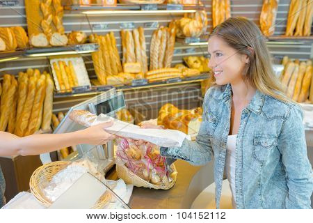 Buying bread from the bakery