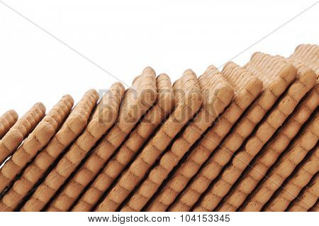 closeup of a line of rectangular cookies on a white background