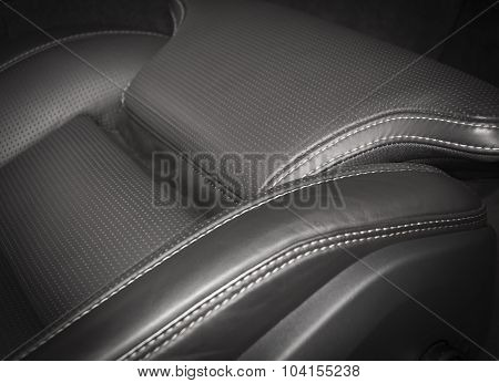Black pefrorated leather