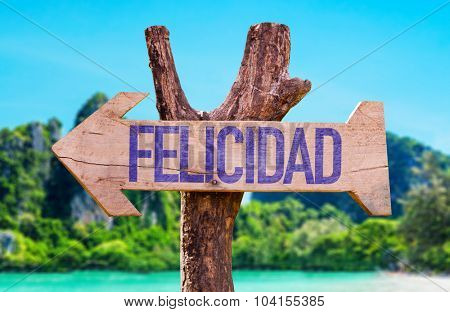 Happiness (in Spanish) arrow with beach background