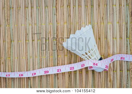White Shuttlecock On Traditional Mat With Measuring Tape, Diet And Fitness Concept