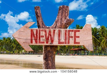 New Life arrow with beach background